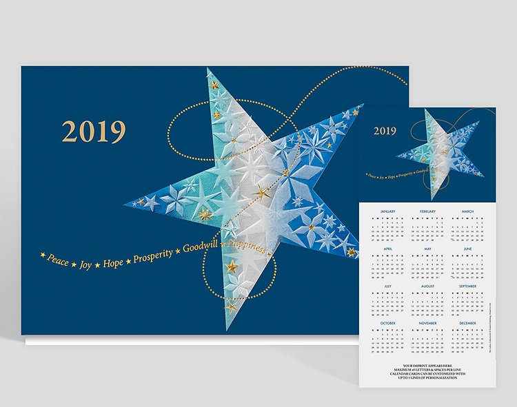 This bold calendar card depicts a beautiful star. The shading of pearl foil streaked through the center adds a striking contrast to the variety of blue shades shown. Coupled with gold foil beading, the message of peace, joy, hope, prosperity, goodwill and happiness streaming across the bottom of the card keeps your holiday sentiments throughout the year.